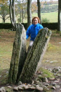 Kathie going through the stones at Clava Cairns