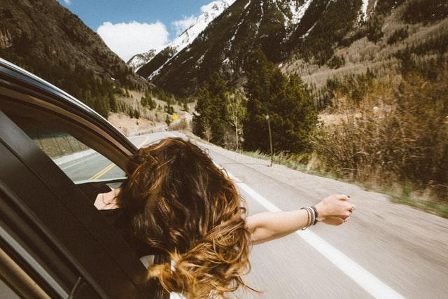 Girl in Car Feeling Free