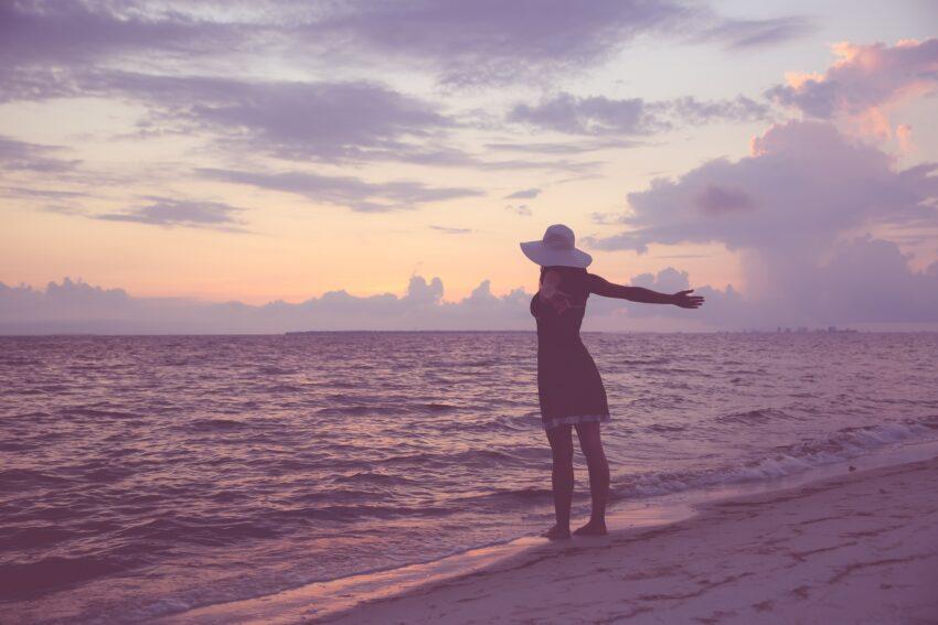 Joyful woman looking at ocean