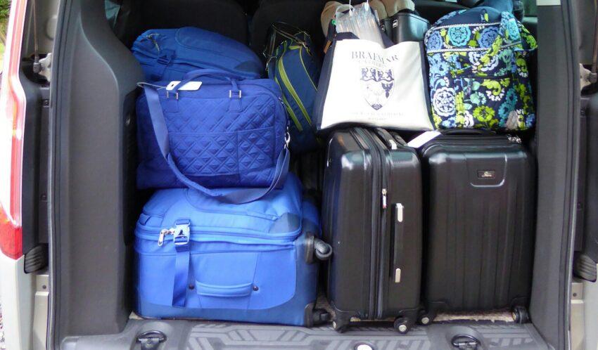 Suitcases in back of van