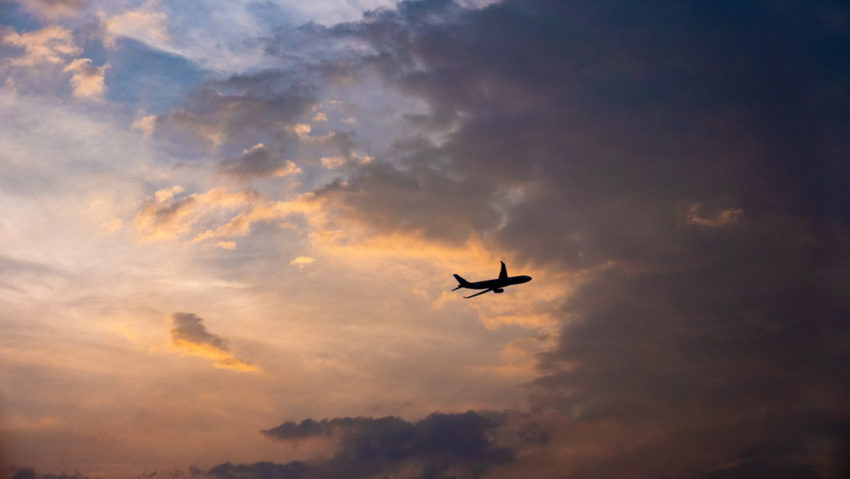 plane leaving at sunset